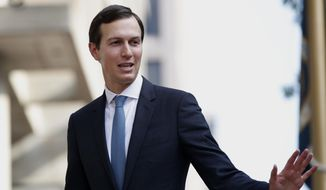 In this Aug. 29, 2018, file photo, Jared Kushner, White House adviser and President Trump's son-in-law, waves as he arrives at the Office of the United States Trade Representative in Washington. (AP Photo/Jacquelyn Martin, File)