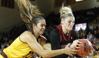 Central Michigan's Reyna Frost, left, and Louisville's Sam Fuehring vie for a rebound during the second quarter of an NCAA college basketball game, Thursday, Dec. 20, 2018, in Mount Pleasant, Mich. (AP Photo/Al Goldis)