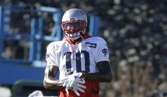 New England Patriots wide receiver Josh Gordon warms up during an NFL football practice, Wednesday, Dec. 19, 2018, in Foxborough, Mass. (AP Photo/Steven Senne) **FILE**