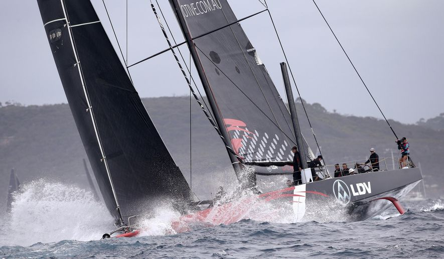 FILE - In this Dec. 26, 2017, file photo, Supermaxi LDV Comanche enters open water at the start of the Sydney Hobart yacht race off Sydney. Comanche skipper Jim Cooney is predicting a quick Sydney to Hobart yacht race but believes his 100-foot super maxi's line honors record will probably stand from 2017. (AP Photo/Rick Rycroft, File)
