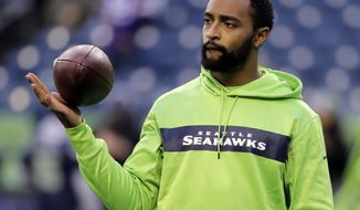 FILE - In this Monday, Dec. 10, 2018, file photo, Seattle Seahawks' Doug Baldwin looks on during warm-up before an NFL football game against the Minnesota Vikings in Seattle. Baldwin has been fortunate to have spent eight years in the NFL without having a season defined injuries affecting his play, until this year. (AP Photo/Ted S. Warren, File)