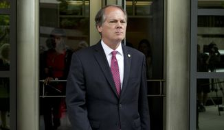 FILE - In this June 13, 2018, file photo, James Wolfe former director of security with the Senate Intelligence Committee leaves the federal courthouse in Washington. Wolfe will serve two months behind bars after he admitted to lying to the FBI. James Wolfe was sentenced Thursday, Dec. 20, in federal court in Washington and will also have to serve four months of supervised release. (AP Photo/Jose Luis Magana, file)