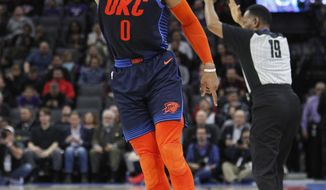 Oklahoma City Thunder guard Russell Westbrook (0) celebrates after hitting a 3-point basket against the Sacramento Kings during the first half of an NBA basketball game in Sacramento, Calif., Wednesday, Dec. 19, 2018. (AP Photo/Steve Yeater)