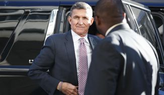 """In this Dec. 18, 2018, photo, President Donald Trump's former national security adviser Michael Flynn arrives at federal court in Washington. President Donald Trump's band of """"my generals"""" is slowly being disbanded. (AP Photo/Carolyn Kaster)"""