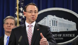 Deputy Attorney General Rod Rosenstein with FBI Director Christopher Wray, speaks during a news conference at the Department of Justice in Washington, Thursday, Dec. 20, 2018. (AP Photo/Manuel Balce Ceneta) ** FILE **