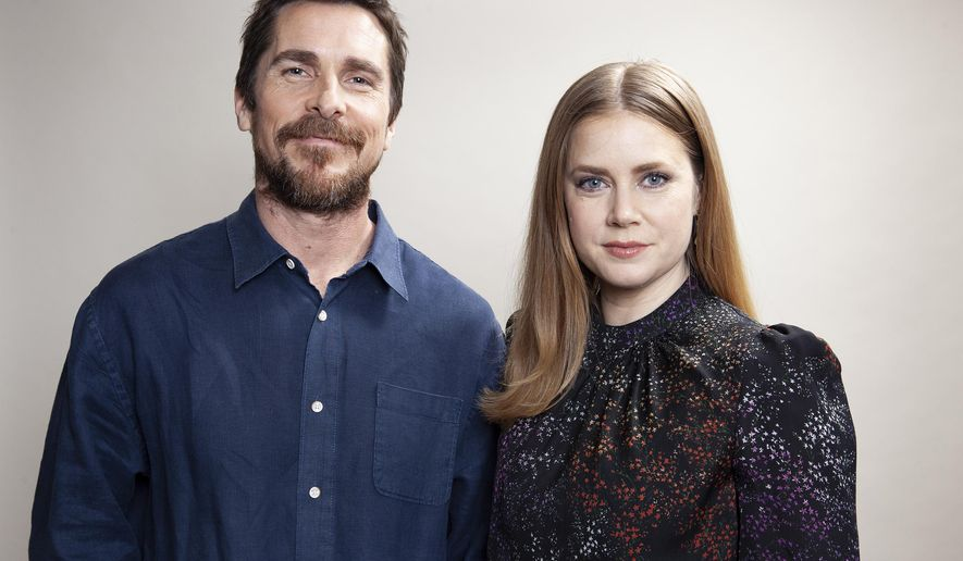 "In this Dec. 10, 2018 photo, actors Christian Bale, left and Amy Adams pose for a portrait to promote their film ""Vice"" at the Viceroy L'Ermitage Beverly Hills, in Beverly Hills, Calif. (Photo by Rebecca Cabage/Invision/AP)"