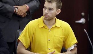 FILE - In this Aug. 22, 2018 file photo, Travis Reinking appears at a hearing in Nashville, Tenn. Reinking, accused of killing four people in a Nashville Waffle House, used to send his father text messages in which he punctuated everyday chitchat with delusional rants. Police say the 29-year-old Reinking was nearly naked, only wearing a green jacket, when he opened fire outside the restaurant on April 22 and then stormed inside. (AP Photo/Mark Humphrey, File)