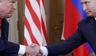 In this Monday, July 16, 2018, photo, U.S. President Donald Trump, left, and Russian President Vladimir Putin, right, shake hand at the beginning of a meeting at the Presidential Palace in Helsinki, Finland. Throughout 2018, special cnvestigator Robert Mueller's team investigated whether Trump's campaign colluded with Russia ahead of the 2016 election and whether the president obstructed the investigation. (AP Photo/Pablo Martinez Monsivais/File)
