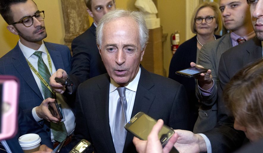 Senate Foreign Relations Committee Chairman Bob Corker, R-Tenn., speaks to reporters as the Senate takes up a House-passed bill that would pay for President Donald Trump's border wall and avert a partial government shutdown, at the Capitol in Washington, Friday, Dec. 21, 2018. (AP Photo/Jose Luis Magana)