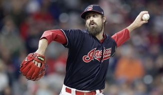 FILE - In this Sept. 22, 2018, file photo, Cleveland Indians relief pitcher Andrew Miller delivers in the seventh inning of a baseball game against the Boston Red Sox, in Cleveland. Andrew Miller is heading west: The free agent left-handed reliever  has agreed to terms with the St. Louis Cardinals on a two-year deal with a vesting option for 2021.Miller gives the Cardinals a long-sought elite option in the bullpen. Terms were not disclosed Friday, Dec. 21, 2018.(AP Photo/Tony Dejak, File)