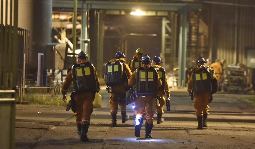 A rescue team is pictured at the CSM coal mime in Karvina, Czech Republic, Tursday, Dec. 20, 2018. The death toll in a methane explosion that hit the coal mine in northeast Czech Republic increased to 13, a mining company said Friday. (Jaroslav Ozana/CTK via AP)