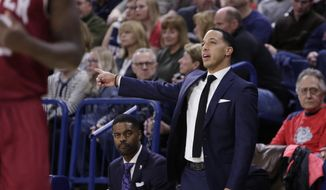 Denver head coach Rodney Billups directs his team during the first half of an NCAA college basketball game against Gonzaga in Spokane, Wash., Friday, Dec. 21, 2018. (AP Photo/Young Kwak)