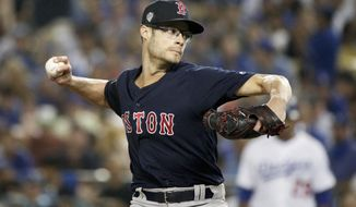FILE - In this Friday, Oct. 26, 2018 file photo,Boston Red Sox relief pitcher Joe Kelly throws against the Los Angeles Dodgers during the sixth inning in Game 3 of the World Series baseball game in Los Angeles. Reliever Joe Kelly agreed Thursday, Dec. 13, 2018 to a $25 million, three-year contract with the Los Angeles Dodgers, a person familiar with the negotiations told The Associated Press. (AP Photo/Jae C. Hong, File)
