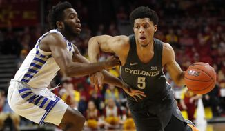 Iowa State guard Lindell Wigginton (5) drives to the basket past Eastern Illinois guard Kashawn Charles during the first half of an NCAA college basketball game Friday, Dec. 21, 2018, in Ames, Iowa. (AP Photo/Charlie Neibergall)
