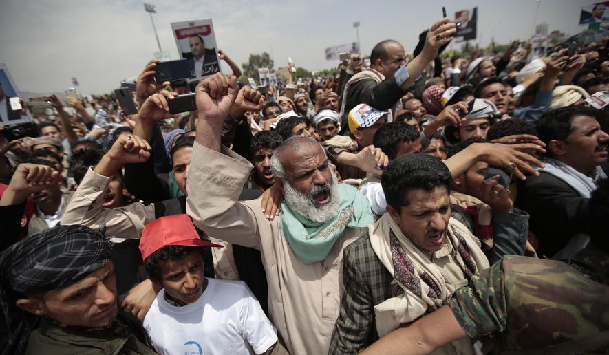 Houthi Shiite mourners chant slogans as they attend the funeral of Saleh al-Samad, a senior Houthi official who was killed by a Saudi-led coalition airstrike on April 19, in Sanaa, Yemen, Saturday, April 28, 2018. (AP Photo/Hani Mohammed)