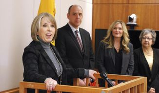 New Mexico Gov.-elect Michelle Lujan Grisham, left, announces the nominations of newly-appointed agency heads, from second left, Ken Ortiz, Alicia Keyes and Marguerite Salazar in Santa Fe, N.M. Ortiz will lead the General Services Department, Keyes will be secretary of economic development, and Salazar well lead the Regulation and Licensing Department. (AP Photo/Morgan Lee)