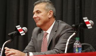 FILE - In this Dec. 4, 2018, file photo, Ohio State head football coach Urban Meyer answers questions during a news conference announcing his retirement, in Columbus, Ohio. (AP Photo/Jay LaPrete, File)