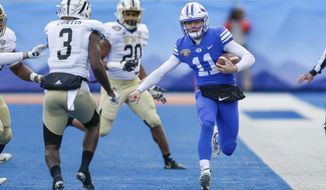 BYU quarterback Zach Wilson (11) runs down the sideline against Western Michigan in the first half of the Famous Idaho Potato Bowl NCAA college football game, Friday, Dec. 21, 2018, in Boise, Idaho. (AP Photo/Steve Conner)