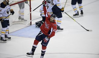 Washington Capitals right wing Tom Wilson (43) celebrates his goal during the third period of an NHL hockey game against the Buffalo Sabres, Friday, Dec. 21, 2018, in Washington. (AP Photo/Nick Wass)