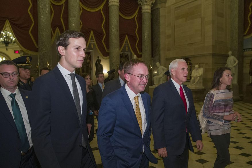 Vice President Mike Pence, second from right, walks with incoming White House Chief of Staff Mick Mulvaney, center, and White House senior adviser Jared Kushner, second from left, after meetings to pass a bill that would pay for President Donald Trump's border wall and avert a partial government shutdown, on Capitol Hill, Friday, Dec. 21, 2018 in Washington. (AP Photo/Alex Brandon)
