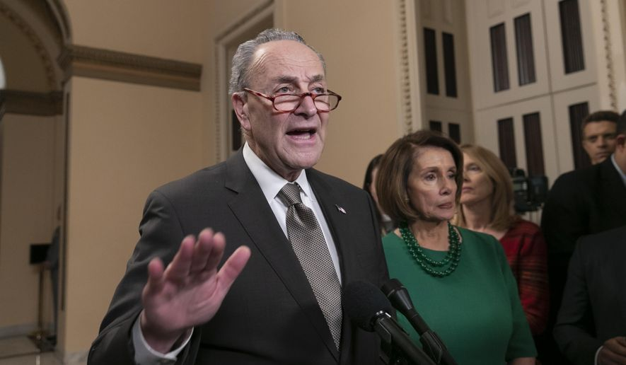 Senate Minority Leader Chuck Schumer, D-N.Y., and House Democratic Leader Nancy Pelosi of California, the speaker-designate for the new Congress, talk to reporters as a revised spending bill is introduced in the House that includes $5 billion demanded by President Donald Trump for a wall along the U.S.-Mexico border, as Congress tries to avert a partial shutdown, in Washington, Thursday, Dec. 20, 2018. (AP Photo/J. Scott Applewhite) **FILE**