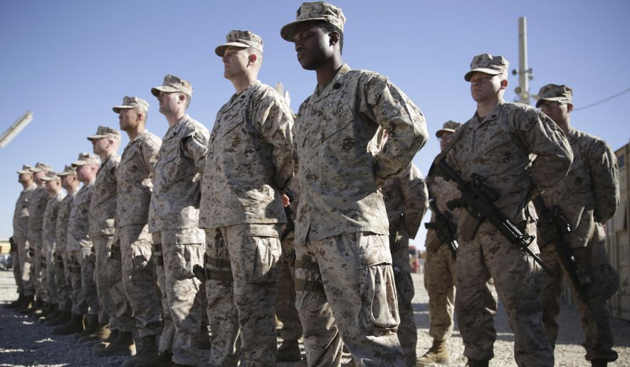 In this Jan. 15, 2018, file photo, U.S. Marines stand guard during the change of command ceremony at Task Force Southwest military field in Shorab military camp of Helmand province, Afghanistan. (AP Photo/Massoud Hossaini) ** FILE **