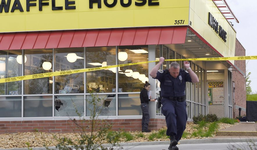 FILE- In this Sunday, April 22, 2018 file photo, law enforcement officials work the scene of a fatal shooting at a Waffle House in the Antioch neighborhood of Nashville, Tenn. This was one of the top stories in 2018 in Tennessee. (George Walker IV/The Tennessean via AP, File)