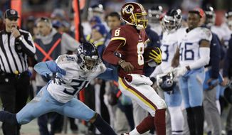 Washington Redskins quarterback Josh Johnson (8) is run out of bounds by Tennessee Titans free safety Kevin Byard (31) in the second half of an NFL football game Saturday, Dec. 22, 2018, in Nashville, Tenn. (AP Photo/James Kenney)