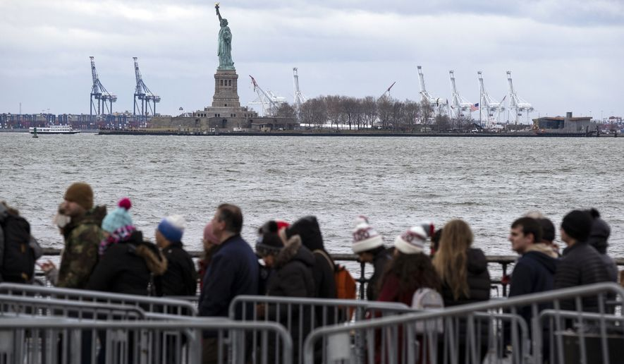 People line up to board a ferry to visit the Statue of Liberty Saturday, Dec. 22, 2018, in New York. The national landmark remained open despite a partial government shutdown after New York Governor Andrew Cuomo made funding available to keep the monument open. (AP Photo/Craig Ruttle)