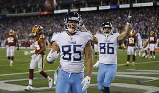 Tennessee Titans tight end MyCole Pruitt (85) flips the ball over his shoulder after he scored a touchdown on a 2-yard pass reception against the Washington Redskins in the second half of an NFL football game Saturday, Dec. 22, 2018, in Nashville, Tenn. (AP Photo/James Kenney)