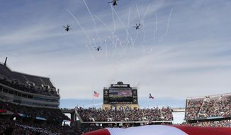 United States military helicopters fly over the stadium during the national anthem before the Armed Forces Bowl NCAA college football game between Houston and Army, Saturday, Dec. 22, 2018, in Fort Worth, Texas. (AP Photo/Jim Cowsert)