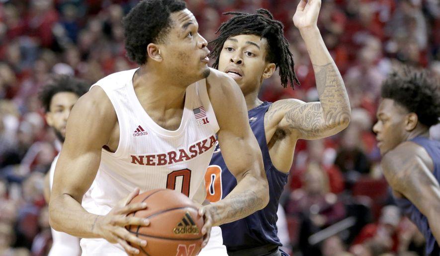 Nebraska's James Palmer Jr. (0) is defended by Cal State Fullerton's Kyle Allman Jr., rear, during the second half of an NCAA college basketball game in Lincoln, Neb., Saturday, Dec. 22, 2018. Nebraska won 86-62. (AP Photo/Nati Harnik)