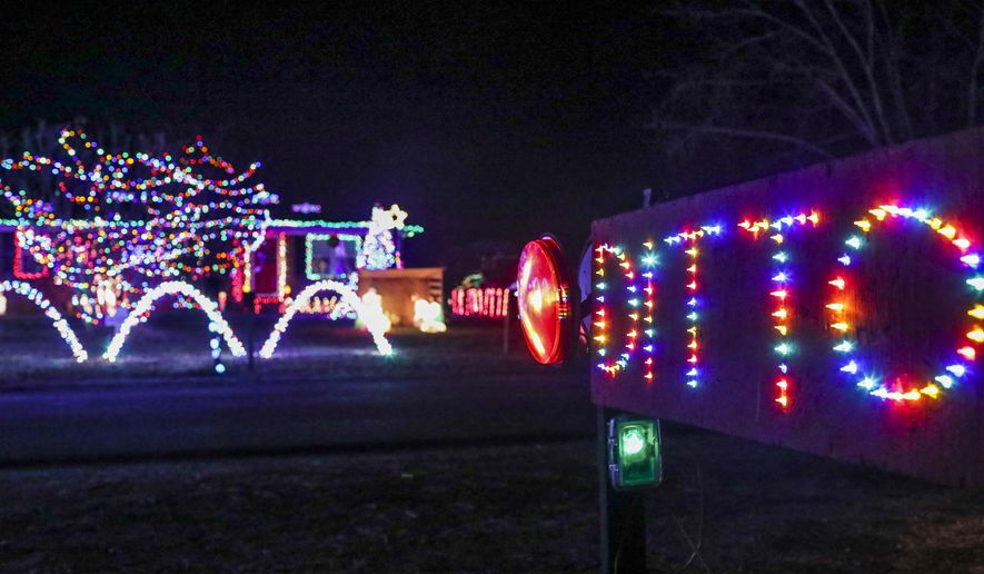 In this Thursday, Dec. 20, 2017 photo, a neighbor's response, right, is pointed at te Christmas light display illuminated outside the home of Jackie Cherry in Bowling Green, Ky. (Austin Anthony/Daily News via AP)