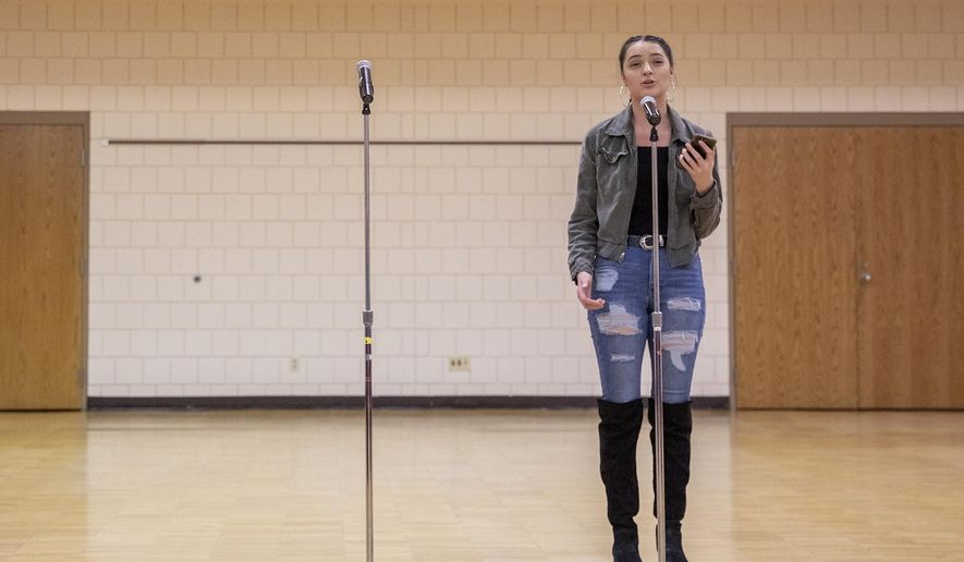 ADVANCE FOR USE SATURDAY, DEC. 22 - In this Thursday, Dec. 13, 2018, Tyra Akers, a junior at Pine Ridge, S.D., High School, performs during a poetry slam at the Lakota Nation Invitational at Rushmore Plaza Civic Center in Rapid City, S.D.. (Ryan Hermens/Rapid City Journal via AP)