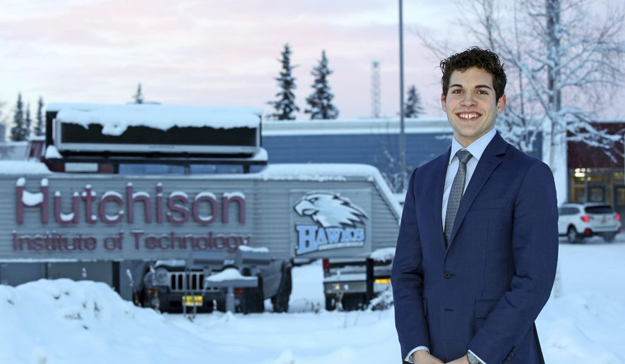 In this Dec. 12, 2018 photo, Hutchison High School junior and Fairbanks North Star Borough School Board student representative Alden Jerome poses outside his school in Fairbanks, Alaska. (Eric Engman/Fairbanks Daily News-Miner via AP)