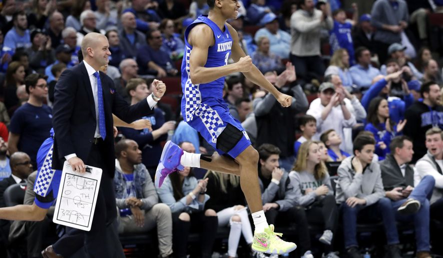 Kentucky guard Keldon Johnson jumps as he celebrates during the second half of an NCAA college basketball game against North Carolina in the fifth annual CBS Sports Classic, Saturday, Dec. 22, 2018, in Chicago. Kentucky won 80-72. (AP Photo/Nam Y. Huh)