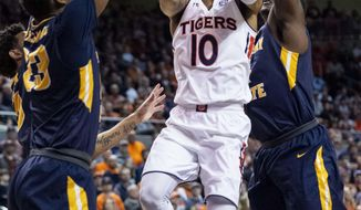 Auburn guard Samir Doughty (10) works between Murray State forwards KJ Williams (23) and Brion Sanchious (4) during the second half of an NCAA college basketball game Saturday, Dec. 22, 2018, in Auburn, Ala. (AP Photo/Vasha Hunt)