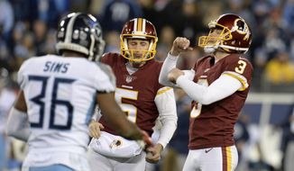 Washington Redskins kicker Dustin Hopkins (3) celebrates after kicking a 40-yard field goal against the Tennessee Titans in the second half of an NFL football game Saturday, Dec. 22, 2018, in Nashville, Tenn. With Hopkins is holder Tress Way (5). (AP Photo/Mark Zaleski) **FILE**