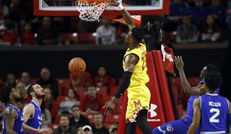 Maryland forward Bruno Fernando, center, of Angola, dunks the ball in the first half of an NCAA college basketball game against Seton Hall, Saturday, Dec. 22, 2018, in College Park, Md. (AP Photo/Patrick Semansky)