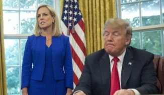 In this June 20, 2018, file photo, President Donald Trump, right, listens as Homeland Security Secretary Kirstjen Nielsen, left, addresses members of the media before Trump signs an executive order to end family separations at the border, during an event in the Oval Office of the White House in Washington. (AP Photo/Pablo Martinez Monsivais, File)
