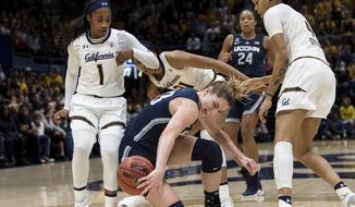 Connecticut guard/forward Katie Lou Samuelson, center, loses possession after colliding with California guard Asha Thomas (1) and forward Alaysia Styles, right, in the second quarter of an NCAA college basketball game Saturday, Dec. 22, 2018, in Berkeley, Calif. (AP Photo/John Hefti)