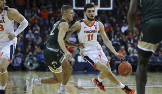 Virginia's guard Ty Jerome (11) drives around William & Mary's guard Luke Loewe (12) in the first half of an NCAA college basketball game,  Saturday, Dec. 22, 2018 in Charlottesville, Va. (AP Photo/Zack Wajsgras)