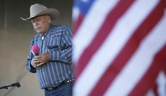 In this April 11, 2015, file photo, rancher Cliven Bundy speaks at an event in Bunkerville, Nev. Bundy has long resisted federal control of public land, culminating in an armed standoff in 2014 on U.S. Bureau of Land Management acreage in Nevada. Some Western lawmakers are arguing that BLM headquarters should be moved from Washington, D.C., to the West, where most public lands are. (AP Photo/John Locher, File)