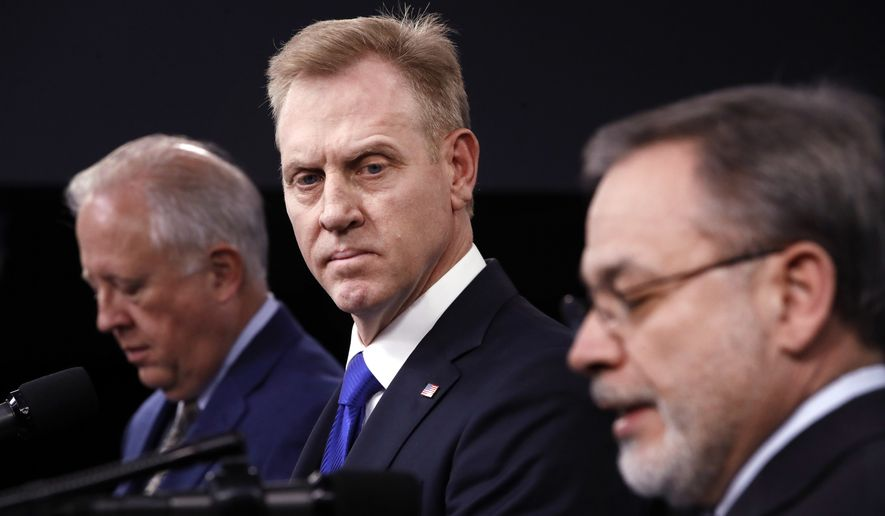 Under Secretary of State for Political Affairs Thomas Shannon, left, and Deputy Defense Secretary Patrick Shanahan, listen as Deputy Energy Secretary Dan Brouillette, right, speaks during a news conference on the 2018 Nuclear Posture Review, at the Pentagon, Friday, Feb. 2, 2018. (AP Photo/Jacquelyn Martin)