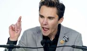 """David Hogg, a survivor of the mass shooting at Marjory Stoneman Douglas High School in Parkland, Fla., speaks during the """"March for Our Lives"""" rally in support of gun control in Washington, Saturday, March 24, 2018. (AP Photo/Andrew Harnik)"""