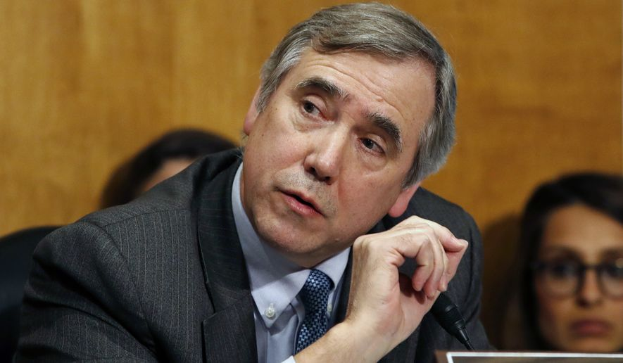 In this April 12, 2018 photo, Sen. Jeff Merkley, D-Ore., questions Secretary of State-designate Mike Pompeo during a Senate Foreign Relations Committee confirmation hearing on Capitol Hill in Washington. A lawsuit filed by Merkley aiming to compel the Trump administration to release 100,000 pages of documents on Supreme Court nominee Brett Kavanaugh is inching forward in federal court, with an Obama nominee assigned to hear it. (AP Photo/Jacquelyn Martin, File)