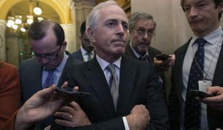 Senate Foreign Relations Committee Chairman Bob Corker, R-Tenn., speaks to reporters as the Senate takes up a House-passed bill that would pay for President Donald Trump's border wall and avert a partial government shutdown, at the Capitol in Washington, Friday, Dec. 21, 2018. (AP Photo/J. Scott Applewhite)