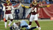 Washington Redskins inside linebacker Mason Foster (54) and free safety D.J. Swearinger (36) celebrate after a play in the second half of an NFL football game against the Tennessee Titans Saturday, Dec. 22, 2018, in Nashville, Tenn. The Titans won 25-16. (AP Photo/Mark Zaleski) ** FILE **