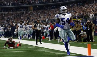 Tampa Bay Buccaneers quarterback Jameis Winston, left on field, looks on as Dallas Cowboys linebacker Jaylon Smith (54) scores a touchdown after recovering a Winston fumble in the first half of an NFL football game in Arlington, Texas, Sunday, Dec. 23, 2018. (AP Photo/Ron Jenkins)