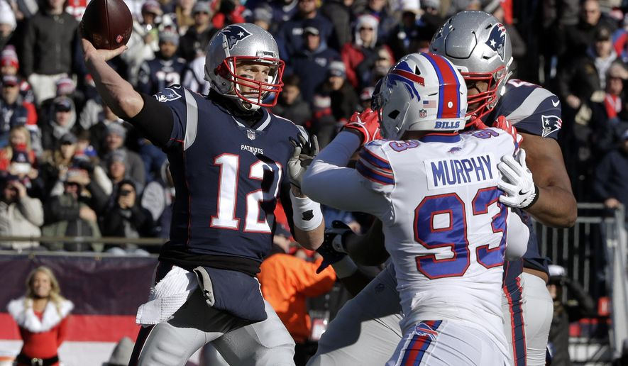 New England Patriots quarterback Tom Brady (12) passes under pressure from Buffalo Bills defensive end Trent Murphy (93) during the first half of an NFL football game, Sunday, Dec. 23, 2018, in Foxborough, Mass. (AP Photo/Steven Senne)